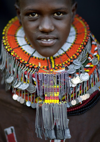 Turkana girl with a giant necklaces covered with pendants - Kenya