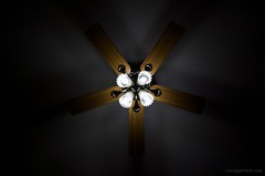 macro photography(0.0), symmetry(1.0), yellow(1.0), light(1.0), ceiling fan(1.0), ceiling(1.0), mechanical fan(1.0), darkness(1.0), lighting(1.0),