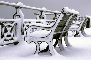 Snow Covered Bench on Hove Promenade.