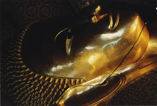 Head and features of massive reclining Lord Buddha, pilgrimage, Bangkok, Thailand, 1993