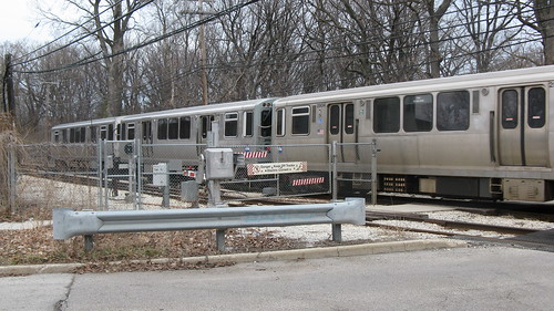 Northbound CTA Purple line train at the Isabella Street railroad crossing. Wilmette Illinois. Early March 2009. by Eddie from Chicago