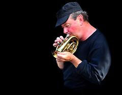 tuba(0.0), saxophone(0.0), guitarist(0.0), horn(0.0), singing(0.0), trumpet(1.0), music(1.0), trumpeter(1.0), brass instrument(1.0), wind instrument(1.0),
