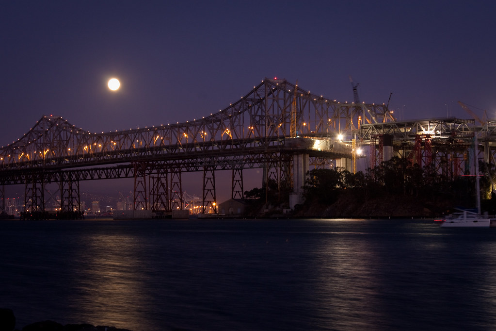Bay Bridge bypass: Moonrise behind Bay Bridge by bhautik_joshi