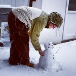 Rosie putting the finishing touches to the snowman for George