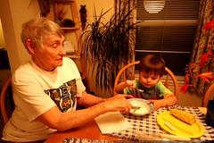 great grandma joan cutting up vanilla ice cream for …