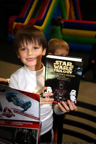 nick got the star wars trilogy from avery. he started reading this in the car on the way home    MG 7976