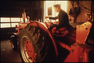 """Wallace """"Whitey"""" Wolf at Work at the Repair Garage for the City ..., 10/1974"""