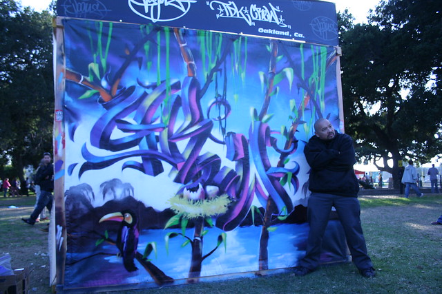 Vogue, winner of the 2009 Estria Art Battle and Festival, standing next to his depiction of the word