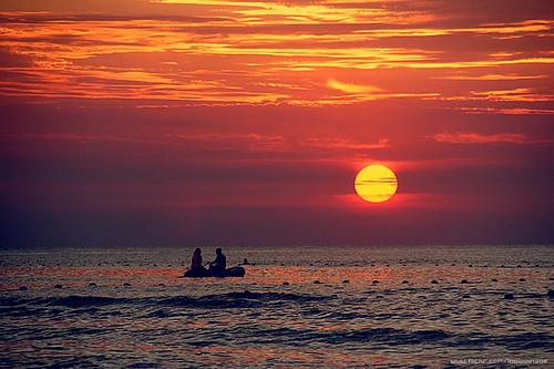 ocean china travel sunset vacation cloud sun beach waves shandong weihai loolooimage