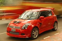 compact sport utility vehicle(0.0), automobile(1.0), automotive exterior(1.0), wheel(1.0), vehicle(1.0), automotive design(1.0), suzuki swift(1.0), city car(1.0), compact car(1.0), bumper(1.0), land vehicle(1.0), hatchback(1.0),