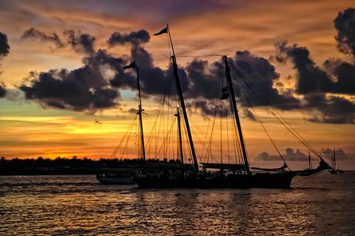 ocean sunset sea gulfofmexico silhouette sailboat explore mast jimmybuffett mallorysquare conchrepublic sunsetcelebration keywestflorida hcs parrotheads chasinglight clichesaturday pixelmama wastingawayagaininmargarittaville obssessedwiththeoceanlately