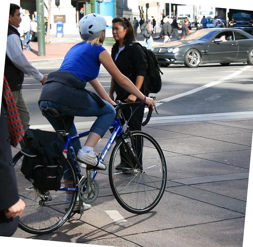 Market Street sidewalk cyclist