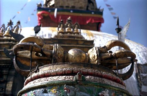 The large metal vajra on a lotus at the top of the staircase, stupa, Tibetan prayer flags, Swayambhunath, Kathmandu, Nepal by Wonderlane