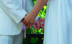 flower(0.0), bride(1.0), hand(1.0), groom(1.0), limb(1.0), interaction(1.0), holding hands(1.0),