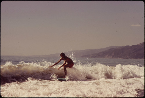 Surfing Along Malibu Beach, California. 10/1972