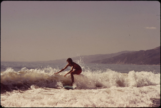 DOCUMERICA: Surfing Along Malibu Beach, California. 10/1972 by Erik Calonius.
