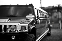 automobile, automotive exterior, wheel, vehicle, automotive design, hummer h2, monochrome photography, bumper, land vehicle, monochrome, luxury vehicle, limousine, black-and-white, motor vehicle,