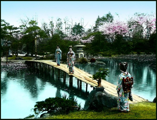 GEISHA ON A BRIDGE OVER THE POND OF FUGETSU GARDEN in OLD JAPAN