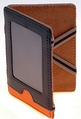 coin purse(0.0), brand(0.0), orange(1.0), brown(1.0), leather(1.0), tan(1.0), wallet(1.0),