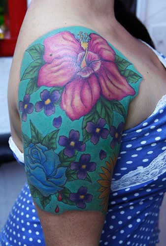 flower-tattoo-on-arm-girl-wearing-polka-dot-dress