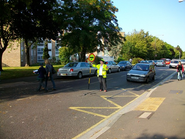 School crossing patrol with children crossing road