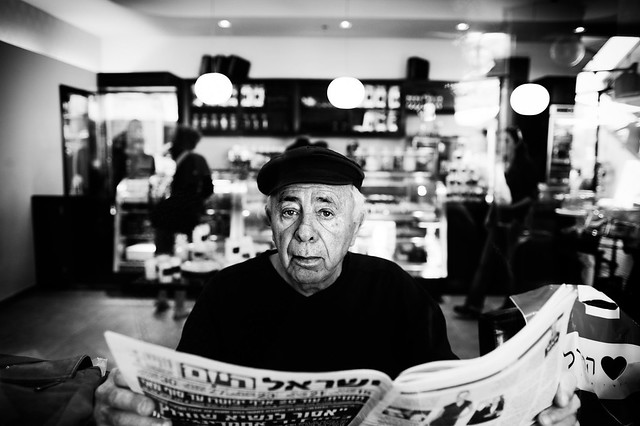 "a man reading the ""Israel Today"" newspaper"
