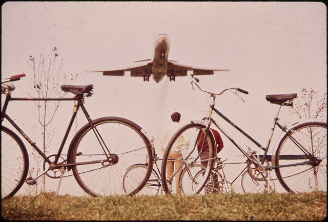 Jet Roars over Bicycle Path near Washington's Nation Airport. Noise-Decibel Level from Aircraft at This Altitude Can Cause Permanent Ear Damage. 11/1972
