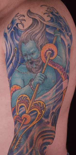 Poseidon fighting an octopus and a shark.