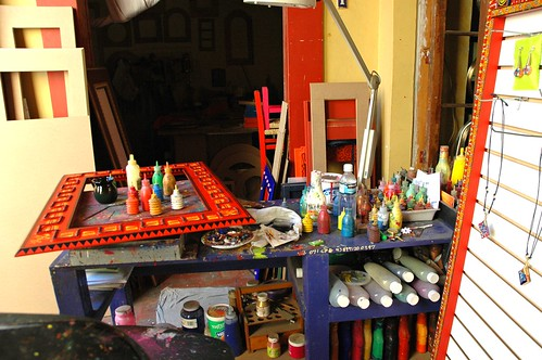 Paint bottles, squeeze type, mirror blanks, painted mirror frame, red, jewelry display, Arcelia Barbero Gomez's studio, Zona Centro, Guadalajara, Jalisco, Mexico by Wonderlane