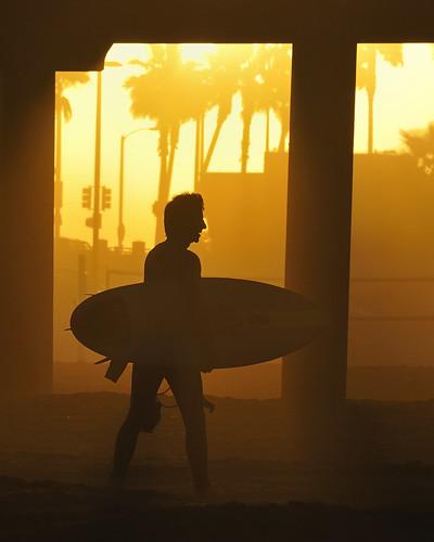 "california light sun sunlight male beach cali golden pier surf waves pacific surfer huntington wave surfing surfboard pilings athlete olas hb ola surfista ""huntingtonbeach"" ""©scottsansenbach2009"" ""allrightsreserved""sunrise"