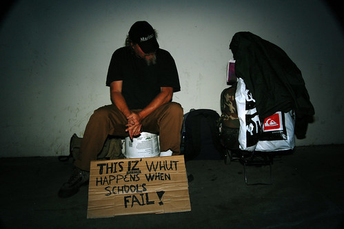 A homeless man under a bridge during a 2009 LAUSD teacher protest.
