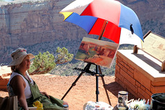 Nancy Lewis painting at the Colorado monument
