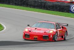 race car(1.0), automobile(1.0), vehicle(1.0), performance car(1.0), automotive design(1.0), ferrari f430 challenge(1.0), race track(1.0), land vehicle(1.0), luxury vehicle(1.0), supercar(1.0), sports car(1.0),