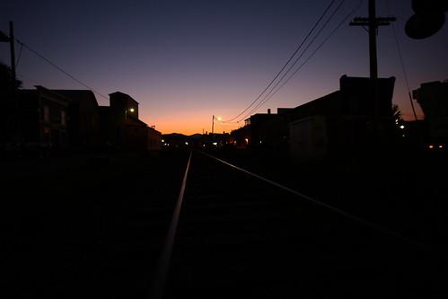 railroad sunset mountains silhouette buildings vermont track sundown dusk rail telephonepole vt randolph canon40d