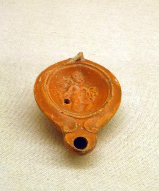 Lamp oil depicting Eros, Roman Period, Ephesus Museum, Selçuk, Turkey
