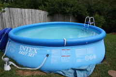 play(0.0), leisure(0.0), jacuzzi(0.0), games(0.0), backyard(1.0), swimming pool(1.0), hot tub(1.0), lawn(1.0), inflatable(1.0),