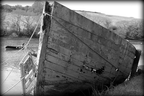 Abandoned fishing boat, beached at Coombe, River Fal, Cornwall by Claire Stocker (Stocker Images)