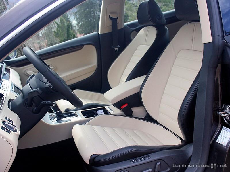 black steering wheel in tan car. Black Bedroom Furniture Sets. Home Design Ideas