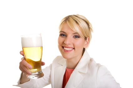 Young blond woman with glass of beer