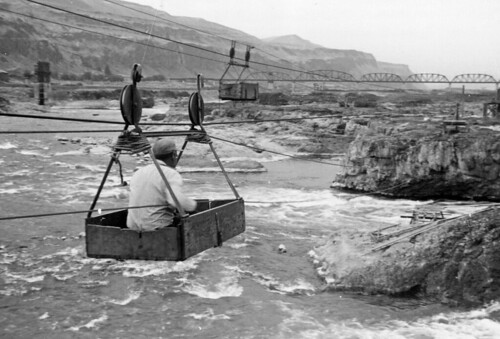 Man in basket above Celilo Falls on the Columbia River