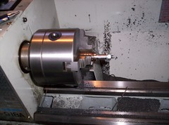 metal lathe(0.0), machine(1.0), tool(1.0), tool and cutter grinder(1.0), machine tool(1.0), lathe(1.0),