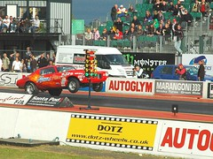 dirt track racing(0.0), auto racing(1.0), racing(1.0), sport venue(1.0), vehicle(1.0), stock car racing(1.0), sports(1.0), race(1.0), motorsport(1.0), drag racing(1.0), race track(1.0), stadium(1.0),