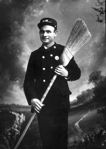 Fireman posed with his broom
