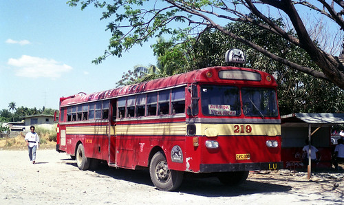 Philippine Rabbit Bus Co Izusu CVC-338 (fleet No 219) at bus and food stop on the highway at Sison, Pangasinan between Tarlac and Baguio, Philippines.