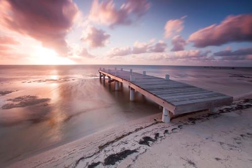 sunrise canon pier bravo belize waterblur ambergriscaye wisdoc belizelegacyresort