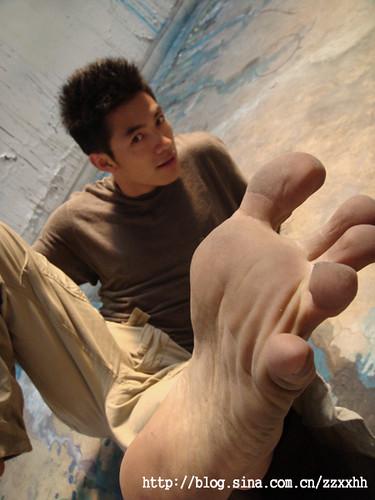 Men lick feet