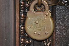 door knocker(0.0), carving(1.0), metal(1.0), bronze(1.0),