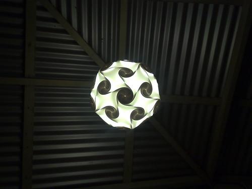 Orbital light against corrugated roof