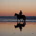 2 of 2 Marlboro Man equestrian male horse rider on the wet sand during an ultra-low -1.7' tide at sunset on Morro Strand State Beach.  Also characteristic of Montana de Oro area to the south.