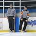 Small photo of Linesman Alex Morrison and Referee Brett Kanemitsu